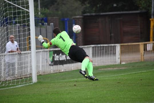 Marcus Garnham Saves a shot. Referee gives goal kick