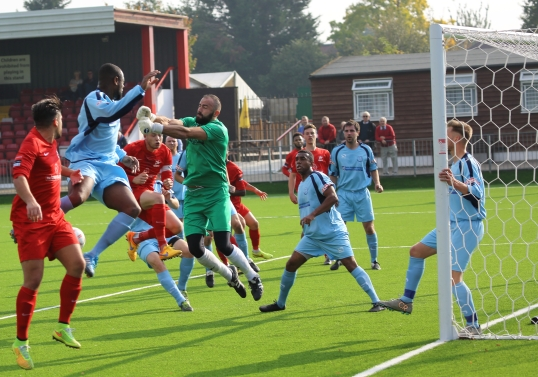 Sam Muzarek punches clear.Carshalton v Leighton FA Trophy 2015